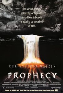 "Image is a poster featuring what appears to be angels fighting in the sky superimposed on clouds while a column of fire with a skeletal face drops to the ground. The title ""The Prophecy"" is displayed at the bottom."